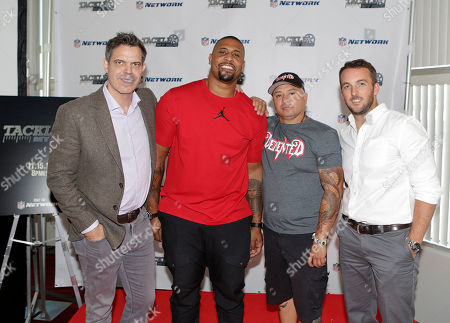 """NFL Network """"Tackle My Ride"""" press event NFL Network show producers, Michael Mandt, left, and Sean Moran, right, pose for a photo with Super Bowl Champion LaMarr Woodley, second left, and Demented Customs master car builder, James Torrez, after a Q&A with NFL Network show producers at the 2016 SEMA Show at Las Vegas Convention Center . NFL Network debuts new reality series """"Tackle My Ride,"""" starring Woodley, and Torrez, with featured Cleveland fan, Joe Whitthorne, not photographed"""