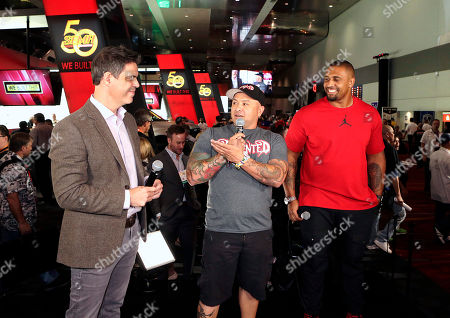 """Stock Photo of NFL Network """"Tackle My Ride"""" press event NFL Network show producer, Michael Mandt, left, and Super Bowl Champion LaMarr Woodley, right, listen as Demented Customs master car builder, James Torrez, center, speaks during a press conference at the 2016 SEMA Show at Las Vegas Convention Center . NFL Network debuts new reality series """"Tackle My Ride,"""" staring Woodley, and Torrez, with featured Cleveland fan, Joe Whitthorne, not photographed"""