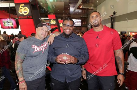 """Stock Photo of NFL Network """"Tackle My Ride"""" press event Demented Customs master car builder, James Torrez, left, Cleveland fan, Joe Whitthorne, center, and Super Bowl Champion LaMarr Woodley, pose for a photo after a press conference at the 2016 SEMA Show at Las Vegas Convention Center . NFL Network debuts new reality series """"Tackle My Ride,"""" staring Woodley, and Torrez, with featured Whitthorne"""