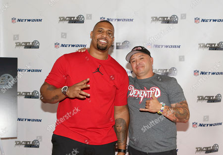 """NFL Network """"Tackle My Ride"""" press event Super Bowl Champion LaMarr Woodley, left, and Demented Customs master car builder, James Torrez, pose for a photo after a Q&A with NFL Network show producers at the 2016 SEMA Show at Las Vegas Convention Center . NFL Network debuts new reality series """"Tackle My Ride,"""" staring Woodley, and Torrez, with featured Cleveland fan, Joe Whitthorne, not photographed"""
