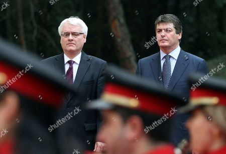 Albania's President Bamir Topi and his Croatian counterpart Ivo Josipovic, left, listen to their national anthems during a welcoming ceremony in Tirana . Josipovic is on a two-day official visit to Albania