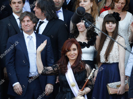 Cristina Fernandez, Amado Boudou, Maximo Kirchner,Maria Rocio Garcia, Florencia Kirchner Argentina's President Cristina Fernandez waves as she leaves National Congress after being sworn in for a second 4-year presidential term in Buenos Aires, Argentina, . Second left is Vice President Amado Boudou, third left is Fernandez's son Maximo Kirchner, his girlfriend Maria Rocio Garcia, and his sister Florencia Kirchner