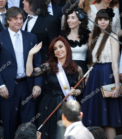Cristina Fernandez, Amado Boudou, Maximo Kirchner,Maria Rocio Garcia, Florencia Kirchner Argentina's President Cristina Fernandez, center, waves as she leaves the National Congress after being sworn in for a second 4-year presidential term in Buenos Aires, Argentina, . At left is Vice President Amado Boudou, second left is Fernandez's son Maximo Kirchner, third left his girlfriend Maria Rocio Garcia, and his sister Florencia Kirchner