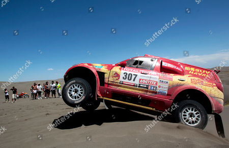 Great Wall driver Carlos Souza, of Portugal, and co-driver Jean-Pierre Garcin from France, compete in the second stage of the 2012 Argentina-Chile-Peru Dakar Rally between Santa Rosa de la Pampa and San Rafael, Argentina