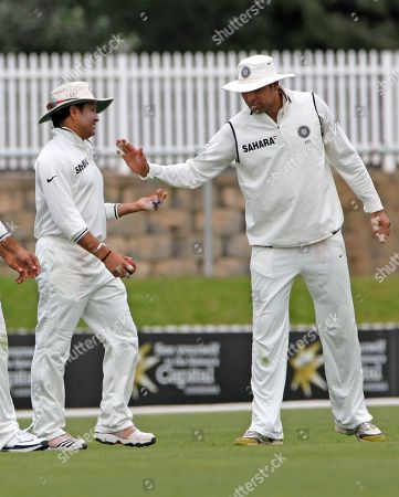 Sachin Tendulkar, VVS Laxman Sachin Tendulkar, left, from India is congratulated by teammate VVS Laxman after taking an easy catch to dismiss Wes Robinson of the Cricket Australia Chairman's XI during the two-day tour match at Manuka Oval in Canberra, Australia