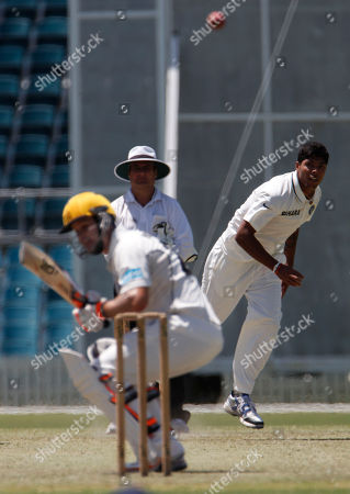 Umesh Yadav, Wes Robinson Umesh Yadav of India bowls a delivery to Wes Robinson of the Cricket Australia Chairman's XI during the two-day tour match at Manuka Oval in Canberra, Australia