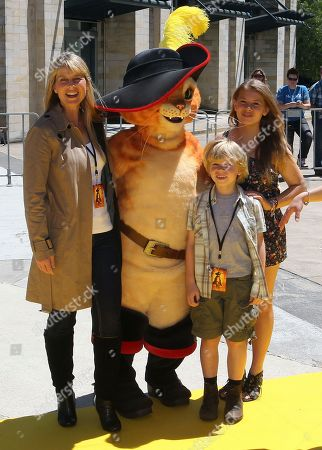 Terry Irwin, Bindi Irwin, Bob Irwin Australians Terry Irwin left, and daughter Bindi right, and son Bob pose with a character from the animation film Puss In Boots during the Australian premier In Boots in Sydney, Australia