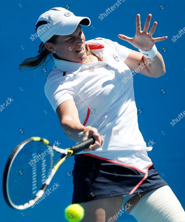Italy's Romina Oprandi makes a forehand return to Anastasiya Yakimova of Belarus during their first round match at the Australian Open tennis championship, in Melbourne, Australia