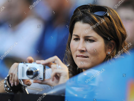 Stock Image of Mirka Vavrinec, wife of Switzerland's Roger Federer takes photos from the players box during his first round match against Russia's Alexander Kudryavtsev at the Australian Open tennis championship, in Melbourne, Australia