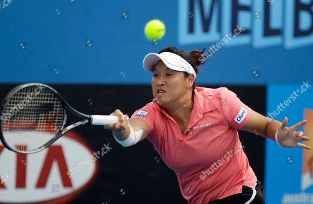 Thailand's Tamarine Tanasugarn makes a forehand return to Russia's Ekaterina Makarova during their first round match at the Australian Open tennis championship, in Melbourne, Australia