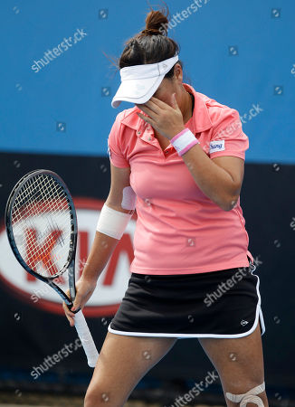 Thailand's Tamarine Tanasugarn reacts during her first round loss to Russia's Ekaterina Makarova in their first round match at the Australian Open tennis championship, in Melbourne, Australia