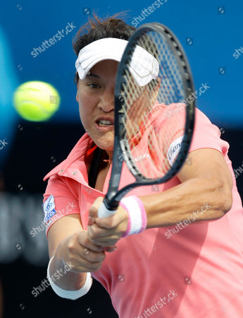 Thailand's Tamarine Tanasugarn makes a backhand return to Russia's Ekaterina Makarova during their first round match at the Australian Open tennis championship, in Melbourne, Australia