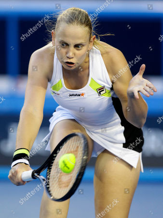 Australia's Jelena Dokic makes a backhand return to France's Marion Bartoli during their second round match at the Australian Open tennis championship, in Melbourne, Australia