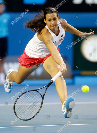 France's Marion Bartoli makes a forehand return to Australia's Jelena Dokic during their second round match at the Australian Open tennis championship, in Melbourne, Australia