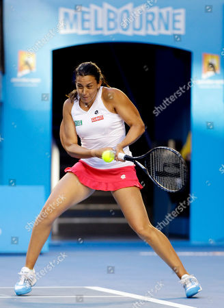 France's Marion Bartoli makes a backhand return to Australia's Jelena Dokic during their second round match at the Australian Open tennis championship, in Melbourne, Australia