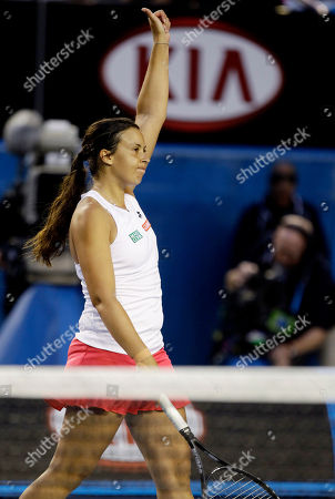 France's Marion Bartoli waves to the crowd after defeating Australia's Jelena Dokic in their second round match at the Australian Open tennis championship, in Melbourne, Australia