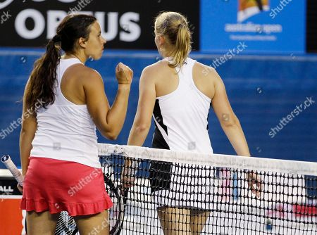 France's Marion Bartoli, celebrates after defeating Australia's Jelena Dokic, right, during their second round match at the Australian Open tennis championship, in Melbourne, Australia