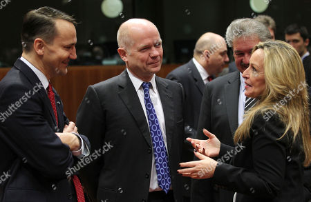 Trinidad Jimenez, Radoslaw Sikorski, William Hague Poland's Foreign Minister Radoslaw Sikorski, left, and British Foreign Secretary William Hague, center, listen to Spain's Foreign Minister Trinidad Jimenez prior to the start of an EU foreign ministers meeting at the European Council building in Brussels, . The British foreign minister is accusing Iran's government of supporting repression in Syria as EU foreign ministers are expected to impose more sanctions on both countries
