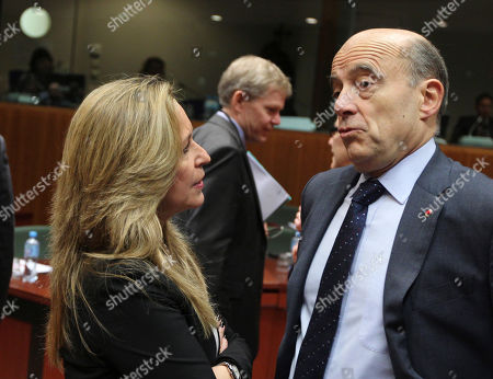 Alain Juppe, Trinidad Jimenez Spain's Foreign Minister Trinidad Jimenez, left, talks with French Foreign Minister Alain Juppe prior to the start of an EU foreign ministers meeting at the European Council building in Brussels, . The British foreign minister is accusing Iran's government of supporting repression in Syria as EU foreign ministers are expected to impose more sanctions on both countries