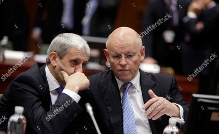 Guilio Terzi di Sant'Agata, Uri Rosenthal Slovakian Foreign Minister Mikulas Dzurinda, left, speaks with Dutch Foreign Minister Uri Rosenthal during a meeting of EU foreign ministers at the EU Council building in Brussels on . EU foreign ministers are set to impose an embargo on Iranian oil to pressure the country to resume talks on its nuclear program