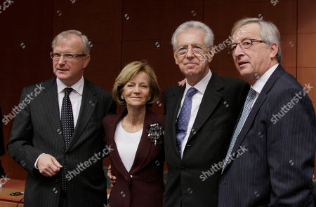 Mario Monti, Jean-Claude Juncker, Elena Salgado, Olli Rehn From left, European Commissioner for the Economy Olli Rehn, Spain's Finance Minister Elena Salgado, Italian Prime Minister and Finance Minister Mario Monti and Luxembourg's Prime Minister Jean-Claude Juncker pose for a photo during a round table meeting of the eurogroup at the EU Council building in Brussels on . The 17 finance ministers of countries that use the euro converged on EU headquarters Tuesday in a desperate bid to save their currency and to protect Europe, the United States, Asia and the rest of the global economy from a debt-induced financial tsunami