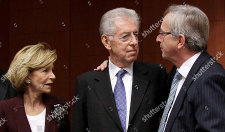 Mario Monti, Jean-Claude Juncker, Elena Salgado Luxembourg's Prime Minister Jean-Claude Juncker, right, speaks with Italian Prime Minister and Finance Minister Mario Monti, center, and Spain's Finance Minister Elena Salgado during a round table meeting of the eurogroup at the EU Council building in Brussels on . The 17 finance ministers of countries that use the euro converged on EU headquarters Tuesday in a desperate bid to save their currency and to protect Europe, the United States, Asia and the rest of the global economy from a debt-induced financial tsunami
