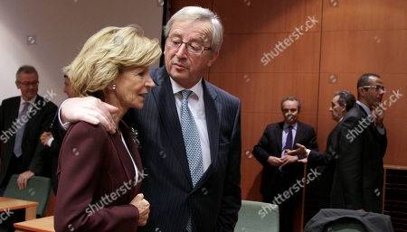 Jean-Claude Juncker, Elena Salgado Luxembourg's Prime Minister Jean-Claude Juncker, right, puts his arm around Spain's Finance Minister Elena Salgado during a round table meeting of the eurogroup at the EU Council building in Brussels on . The 17 finance ministers of countries that use the euro converged on EU headquarters Tuesday in a desperate bid to save their currency and to protect Europe, the United States, Asia and the rest of the global economy from a debt-induced financial tsunami