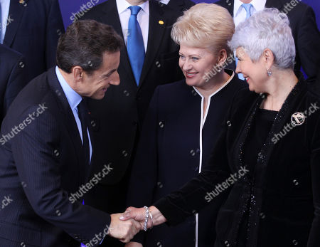 Nicolas Sarkozy, Jadranka Kosor French President Nicolas Sarkozy, left, shakes hands with Croatian Prime Minister Jadranka Kosor, right, during a group photo at an EU summit in Brussels on . The president of the European Council said Friday that a new intergovernmental treaty meant to save the euro currency will include the 17 eurozone states plus as many as six other European Union countries, but not all 27 EU members. Standing center is Lithuanian President Dalia Grybauskaite