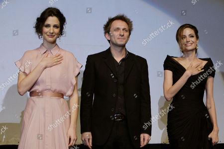 Angelina Jolie Actors of the movie 'In the Land of Blood and Honey', from left to right, Zana Marjanovic,left, Goran Kostic,center, Angelina Jolie, right, greet the audience after a gala premiere in Sarajevo, Bosnia on . Angelina Jolie is in Sarajevo for screening of her film 'In the Land of Blood and Honey