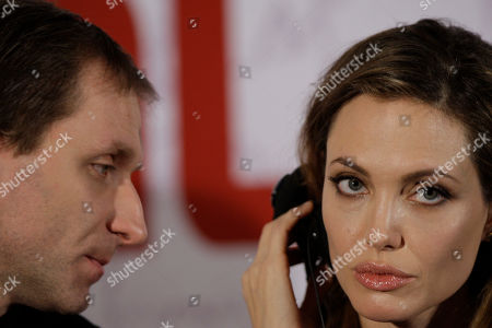 Angelina Jolie, Goran Kostic US actress and director Angelina Jolie, right, accompanied with actor Goran Kostic, addresses journalists during press conference in Sarajevo, Bosnia . She is in Sarajevo for the screening of her film 'In the Land of Blood and Honey