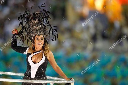Brazilian singer Daniela Mercury performs with the Portela samba school parade during carnival celebrations at the Sambadrome in Rio de Janeiro, Brazil