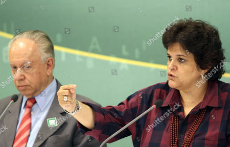 Brazil's Environment Minister Izabella Teixeira, right, speaks about the nearly $28 million fine Chevron faces during a news conference, after a meeting with Brazil's President Dilma Rousseff, at the Planalto presidential palace, in Brasilia, Brazil, . Brazil's environmental agency says it will fine Chevron nearly $28 million for the oil spill in an offshore field operated by Chevron at the Bacia de Campos, in Rio de Janeiro state and will also ask the oil company to pay for damages caused by the Atlantic spill. Pictured next to Teixeira is the President of Brazil's National Petroleum Agency Haroldo Lima