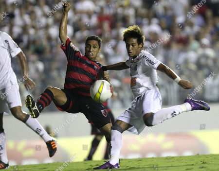 Santos' Neymar, right, and Oeste FC's Eder Lima during a Sao Paulo State soccer league match in Baueri, outskirt of Sao Paulo, Brazil