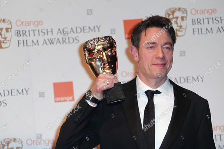Peter Straughan Writer Peter Straughan posing with award for 'Best Adapted Screenplay', for the film Tinker, Tailor, Soldier, Spy backstage at the BAFTA Film Awards 2012, at The Royal Opera House in London