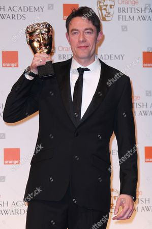 Peter Straughan Screenwriter Peter Straughan with his award for Adapted Screenplay for the film 'Tinker Tailor Soldier Spy' backstage at the BAFTA Film Awards 2012, at The Royal Opera House in London