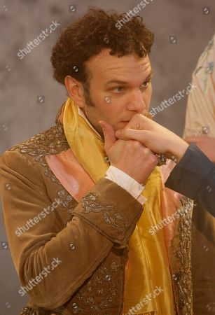 David Sturzaker British actor David Sturzaker who plays Lord Byron kisses a hand of Joe Bannister playing Percy Bysshe Shelley not seen in photograph in Bloody Poetry at Jermyn Street Theatre in central London