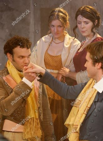 David Sturzaker, Rhiannon Sommers, Joe Bannister, Joanna Christie British actors David Sturzaker who plays Lord Byron kisses a hand of Joe Bannister playing Percy Bysshe Shelley as they are watched by British actresses Joanna Christie on the left who plays Claire Claremont and Rhiannon Sommers playing Mary Shelley in Bloody Poetry at Jermyn Street Theatre in central London