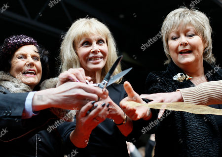 """Bond Girls British actress Eunice Gayson left, Swedish actress Britt Ekland, centre and British actress Jenny Hanley pose for photographers at the opening of the """"Bond in Motion: 50 Vehicles 50 Years"""" exhibit at the National Motor Museum in Beaulieu, southern England"""