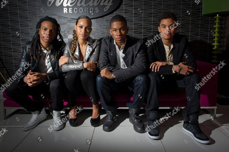 Barry 'Bar-Man' Hill, Amanda Reifer, T-Ray Armstrong, Jamar Harding Barbados-based pop group, Cover Drive, consisting of members, Barry 'Bar-Man' Hill, left, Amanda Reifer, center left, T-Ray Armstrong, center right and Jamar Harding, right, pose for photographs after an interview at Universal Records, London