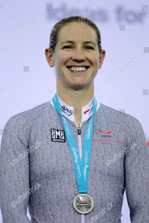 New Zealand's Alison Shanks wears her silver medal after being presented it in the medal ceremony for the women's individual pursuit final during the World Cup track cycling meeting at the London 2012 Olympic Velodrome at the Olympic Park in London