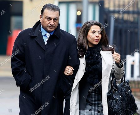 Suspended Metropolitan Police Commander Ali Dizaei, left, arrives with his wife Shai at Southwark Crown Court in London, . Dizaei is facing a retrial at Southwark Crown Court accused of misconduct in a public office and perverting the course of justice