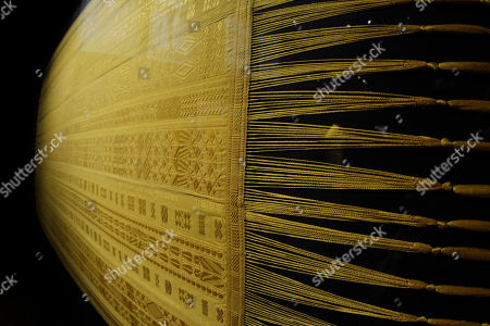Taken with a fisheye lens, a spider silk shawl, designed by Simon Peers and Nicholas Godley, is seen on display at the Victoria and Albert Museum in London, . The shawl is woven and embroidered in Madagascar and is made from the silk of more than a million female Golden Orb Weaver spiders collected in the highlands of Madagascar. The hand-woven textile is naturally golden in colour and took over four years to create