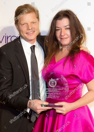 Lynne Ramsay, Luc Roeg Lynne Ramsay and Luc Roeg pose with her British Film Of The Year Award during the 32nd London Critics' Circle Film Awards at the BFI Southbank in central London, . The awards are determined through votes by over 120 UK film critics, broadcasters and writers