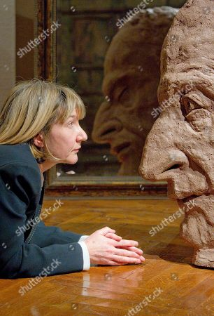 Jane McAdam Freud British artist Jane McAdam Freud is face to face with a large-scale terracotta sculpture called EarthStone, depicting her father Lucian Freud, as part of an exhibition called 'A Personal Portrayal: Sculpture by Jane McAdam Freud', in London's Freud Museum- once home to her great grandfather, Sigmund Freud