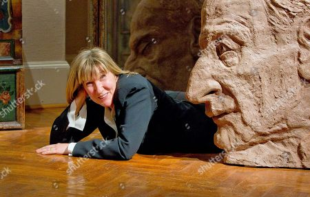 Jane McAdam Freud British artist Jane McAdam Freud lies alongside a large-scale terracotta sculpture called EarthStone, depicting her father Lucian Freud, as part of an exhibition called 'A Personal Portrayal: Sculpture by Jane McAdam Freud', in London's Freud Museum- once home to her great grandfather, Sigmund Freud