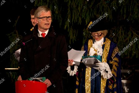 Stock Photo of The Norwegian Ambassador to Britain Kim Traavik, left, speaks flanked by the Lord Mayor of Westminster Susie Burbridge before the lights were switched on of the Norwegian Christmas tree during its annual lighting up ceremony in Trafalgar Square, London, . The Christmas tree is the city of Oslo's traditional Christmas gift to the City of Westminster as a token of thanks for British support during the years of occupation during World War II