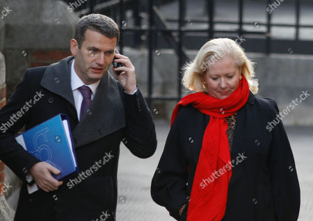 Lawyer Mark Lewis, left, who represents phone hacking victims, escorted by publicist Mary-Ellen Field, arrives to testify at the Leveson inquiry at the Royal Courts of Justice in central London, . The Leveson inquiry is Britain's media ethics probe that was set up in the wake of the scandal over phone hacking at Rupert Murdoch's News of the World, which was shut in July after it became clear that the tabloid had systematically broken the law