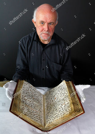 David Jacobs David Jacobs, senior conservator from the British Library displays the Ma'il Qur'an before it is prepared for display at the British Museum in London, . The Ma'il Qur'an is the oldest object to go on public display as part of the British Museum's exhibition, Hajj: journey to the heart of Islam that opens on Jan. 26. This manuscript is from Arabia, probably copied in Mecca or Medina and dates from the 8th century, one of the earliest in existence