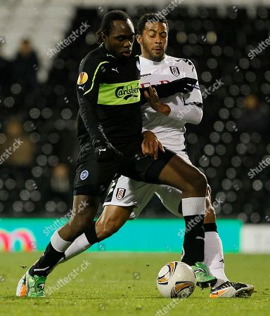 Fulham's Mousa Dembele, right, vies for the ball with Odense's Peter Utaka during their Europa League group k soccer match between Fulham and Odense BK at Craven Cottage Stadium in London