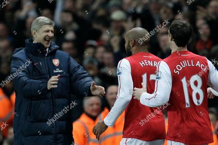 Arsenal's former player and new loan signing Thierry Henry, center, celebrates scoring on his first game back with his French manager Arsene Wenger and Sebastien Squillaci during the English FA Cup 3rd round soccer match between Arsenal and Leeds United at the Emirates Stadium in London